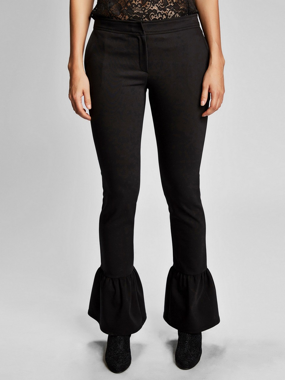 Wooly Trousers With Frilled Lower Side